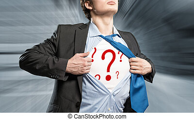 businessman breaks the shirt, under which the question marks...