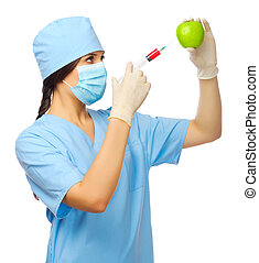 Young doctor with syringe and apple