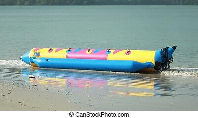 vacant banana boat - Vacant banana boat at the sea shore