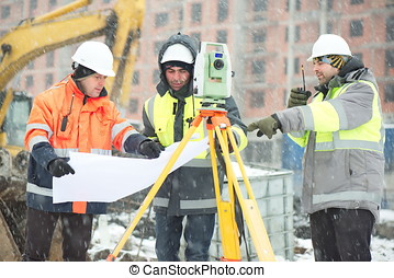 Civil Engineers At Construction - Civil engineers at...