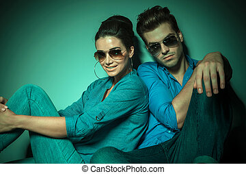 fashion couple leaning on a wall smiling - Fashion woman...