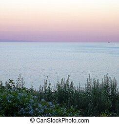 Pink sunset over the italian sea