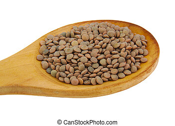 Closup of lentils with wooden spoon isolated on white.