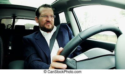 Business man driving car sneezing feeling sick fever