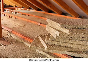 Mineral wool stack on construction site - thermal insulation...