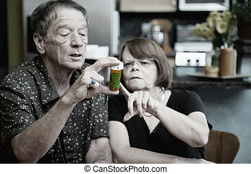 Couple at Home with Medication - Couple at Home Considering...