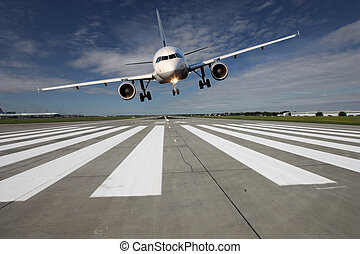 Aircraft low over the runway - Landing aircraft low over the...
