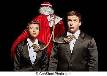 Tense business people tied to Santa Claus - Financial...