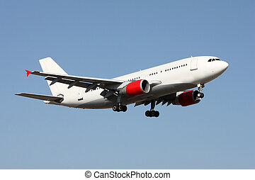 Aircraft - Large passenger airplane in the blue sky