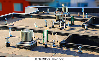 Rooftop Vents - Miscellaneous vents and curved pipes on the...