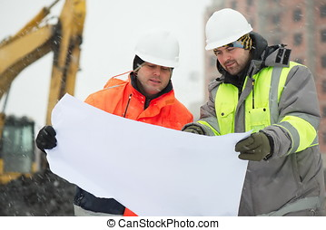 Civil Engineers At Construction Site In Winter Season -...