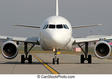 Aircraft on taxiway - White aircraft taxi on taxiway at the...