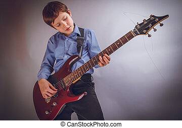 teenager boy of 10 years European appearance rejoices plays...