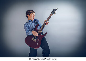 boy adolescence European appearance enthusiastically playing...