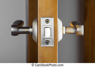 Door Latch - Opened wooden door with latch handle closeup