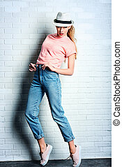 jeans and hat - Fashion photo of an attractive young woman...