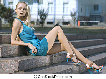 sad blonde in turquoise dress - portrait of a pretty fashion...