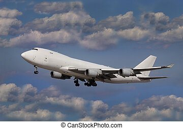 White Aircraft - White plane in the blue sky with clouds