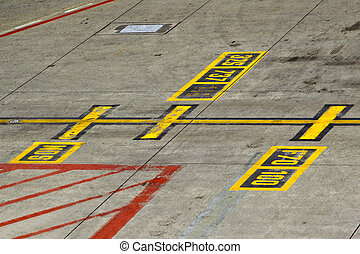 Marking on taxiway aircraft stands at the airport