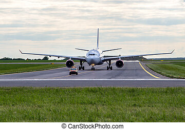Aircraft taxiing for follow me car at the airport