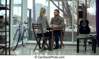 Coffee House Clients - Camera shifting from sweet couple...