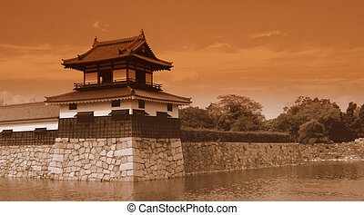 Sepia postcard of a Japanese castle - Sepia aged postcard of...