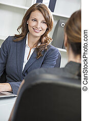 Woman or Businesswoman in Office Meeting - Beautiful young...