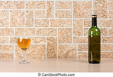 Wineglass on wall - Wine bottle and glass on brick wall...