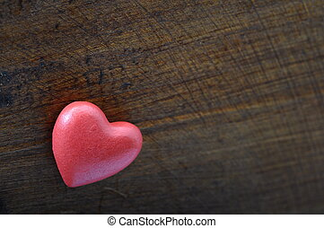 Red heart on wooden background for valentine's day or...