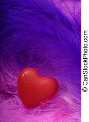 Red heart on feathers - Red heart for love and valentines...