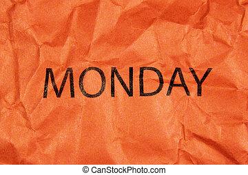 word monday on orange paper
