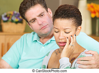 Sad Wife Looking Down - Anxious beautiful young spouse with...