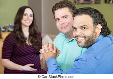 Happy Gay Parents with Pregnant Woman - Handsome gay men...