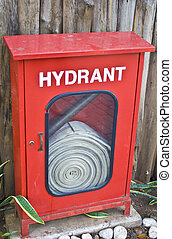 Fire Hydrant Box - Red fire hydrant box with wooden wall as...