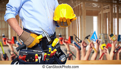 Construction worker with hammer and tools. - Construction...