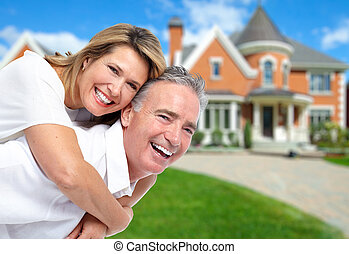 Senior Couple near new house - Happy couple near new home...