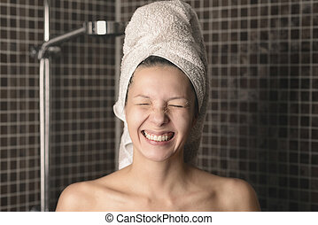 Playful mischievous woman with wet hair in a towel - Playful...