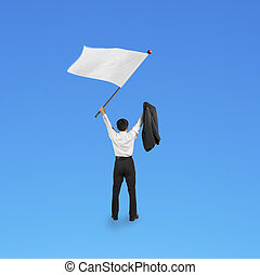 A businessman waving blank white flag isolated on blue...