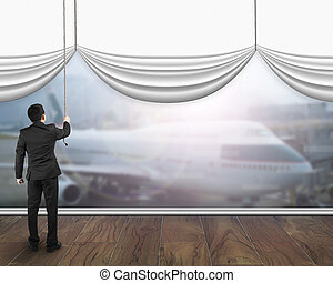 A businessman pulling open white blank curtain showing...