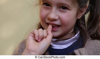 cute little girl with the tooth - pretty little girl with...