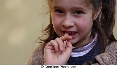 little girl with the tooth that dangles by her hand
