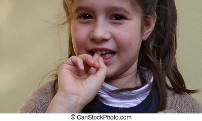 pretty little girl with the tooth - cute little girl with...