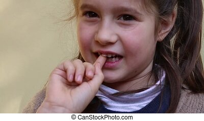 pretty little girl with the tooth that dangles by her hand