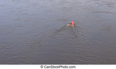 Red buoy marks the fairway on river water