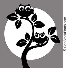 silhouette of two owls in a tree