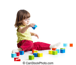 kid playing wooden toys