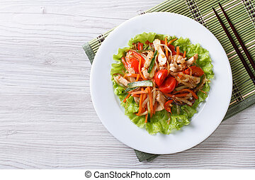 warm salad with chicken and vegetables horizontal top view -...