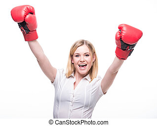 Woman boxing - Business woman is wearing boxing gloves and...