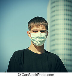 Teenager in Flu Mask - Toned Photo of Teenager in the Flu...