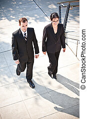 Business people - A shot of two business people walking...